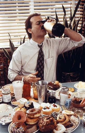 Bill Murray's character, Phil, eating like there's no tomorrow.