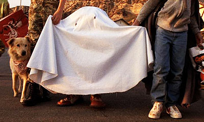 Beloved alien E.T. dressed as a ghost on E.T.