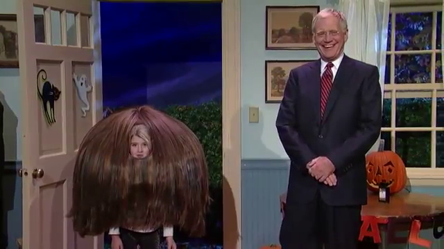 A trick-or-treater dressed as Justin Bieber's hair on The Late Show with David Letterman
