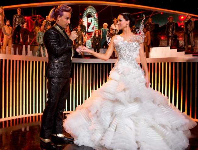 Stanley Tucci as Caesar Flickerman, with  Jennifer Lawrence as Katniss Everdeen in The Hunger Games: Catching Fire