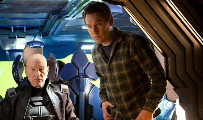 "Director Bryan Singer goes over a scene with Patrick Stewart (""Future"" Professor X)."