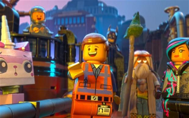 Emmet (Chris Pratt), Vitruvius (Morgan Freeman), and Wyldstyle (Elizabeth Banks)