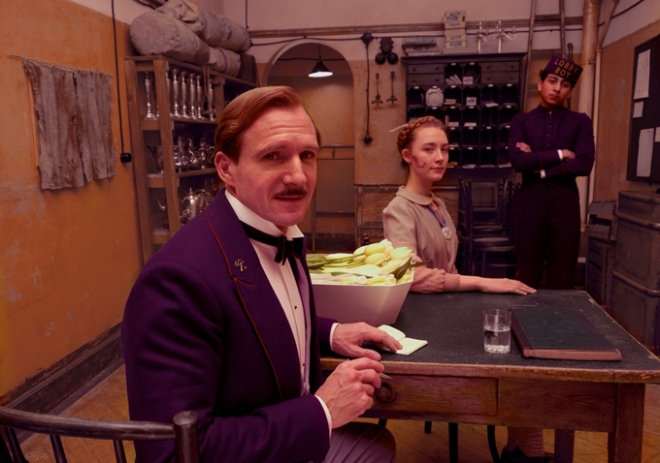 """Ralph Fiennes, Saoirse Ronan, and Tony Revolori in """"The Grand Budapest Hotel"""" (Photo courtesy of Fox Searchlight Pictures)"""
