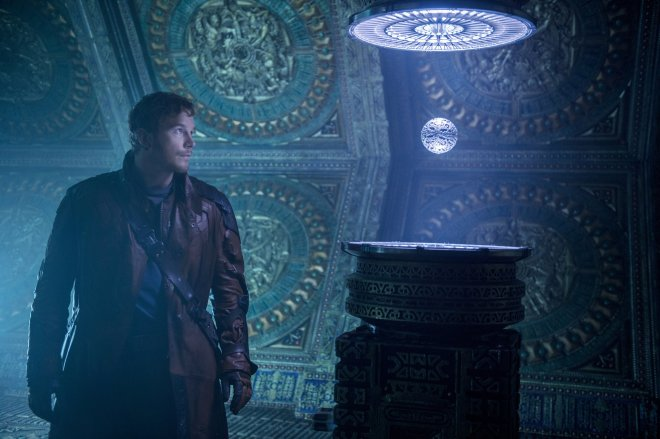 "Peter Quill (Chris Pratt) tries to get ahold of a mysterious orb in ""The Guardians of the Galaxy."" (Photo courtesy of Marvel/Disney)"