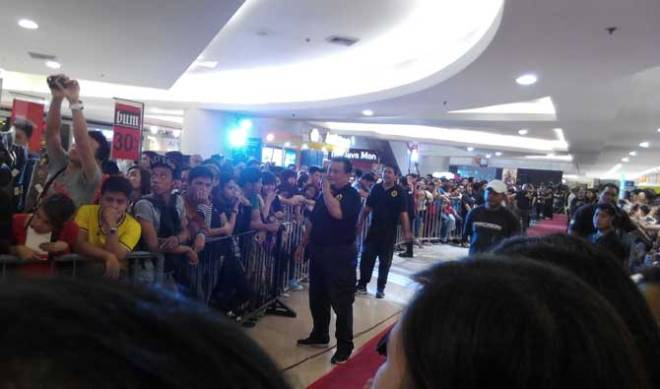 Dedicated fans: Some of them waited for hours to catch a glimpse of their idols.
